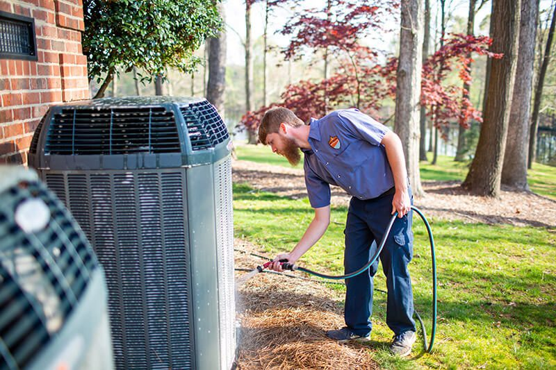 air conditioning technician installing unit
